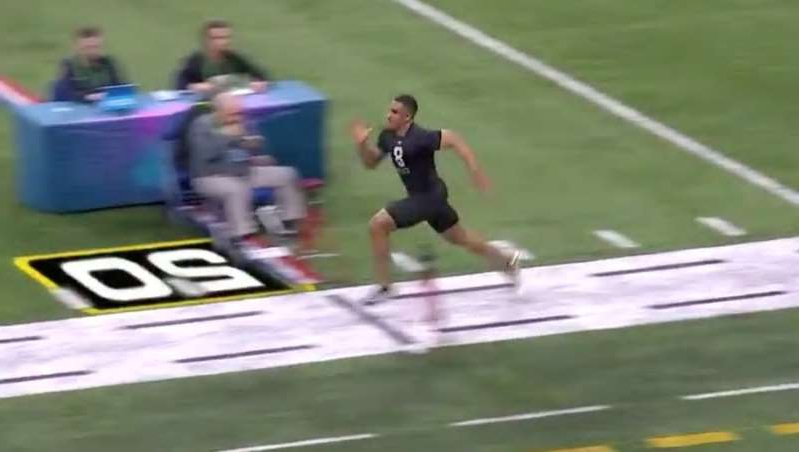 a person riding on top of a grass covered field: Former Oklahoma and Alabama QB Jalen Hurts in 40-Yard Dash at NFL Combine