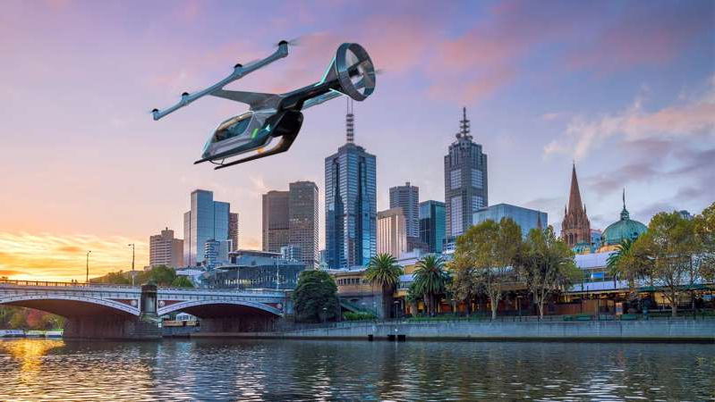 a small boat in a body of water with a city in the background: Melbourne is one of three cities worldwide selected to run a trial for Uber Air. (Supplied: Uber)