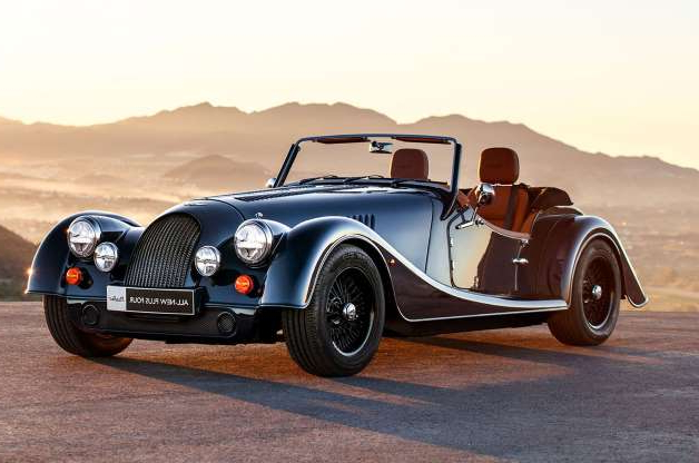 a car parked on the side of a road: New Morgan Plus Four arrives with BMW power, new chassis