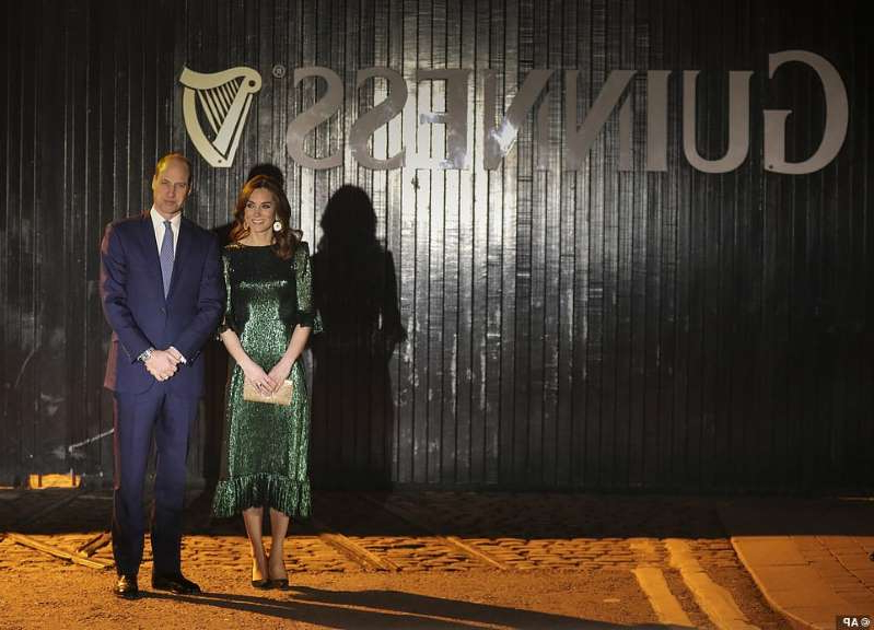 Prince William, Duke of Cambridge standing in front of a sign: The Duke and Duchess of Cambridge have arrived at the Guinness Storehouse for an evening reception. It is the royal couple's final engagement on their first day visiting Ireland