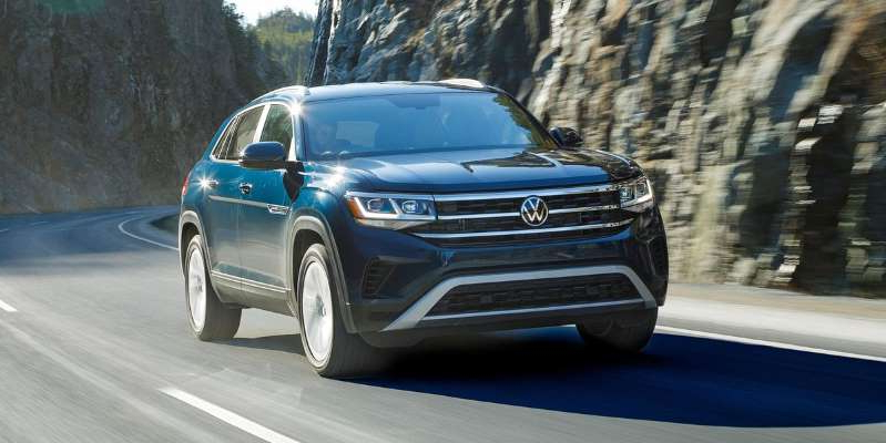 a car parked on the side of a road: A subtle restyling and the removal of its third row doesn't transform VW's mid-size Atlas, but it does put the nameplate into an additional SUV segment.