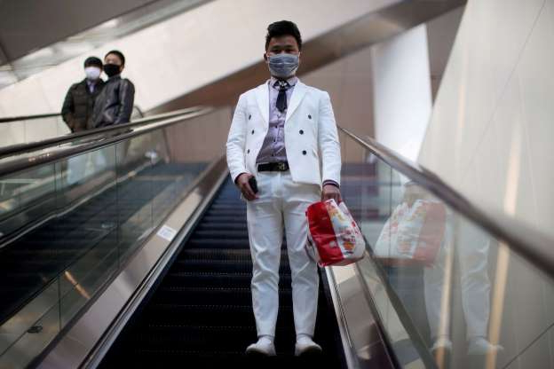 Slide 1 of 182: A man wearing a face mask rides an escalator at the Shanghai Hongqiao Railway Station on the last day of the Spring Festival travel rush, as the country is hit by an outbreak of the novel coronavirus, in Shanghai, China February 18, 2020.  REUTERS/Aly Song     TPX IMAGES OF THE DAY