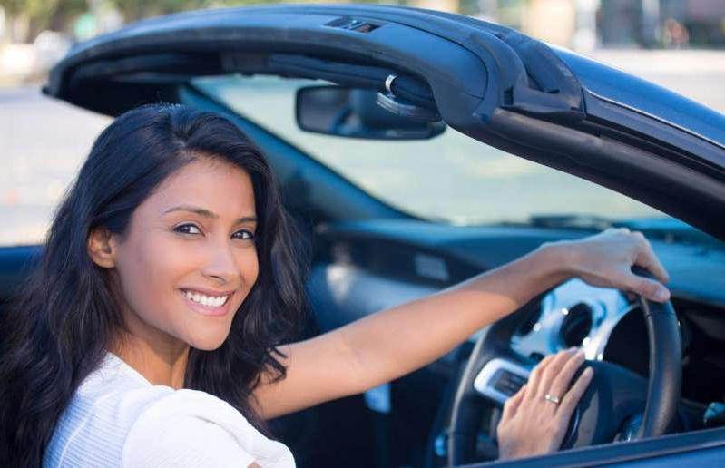 a woman in a car: shutterstock_345801488