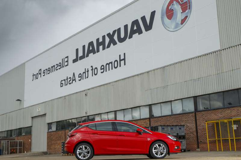 a car parked in front of a building: PSA builds the Vauxhall Astra at Ellesmere Port in Cheshire