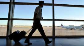 a person standing next to a window: Air Canada says its flight and cabin crew are exempt from suggestions to self isolate for two weeks because of the risk of coronavirus after leaving the country.