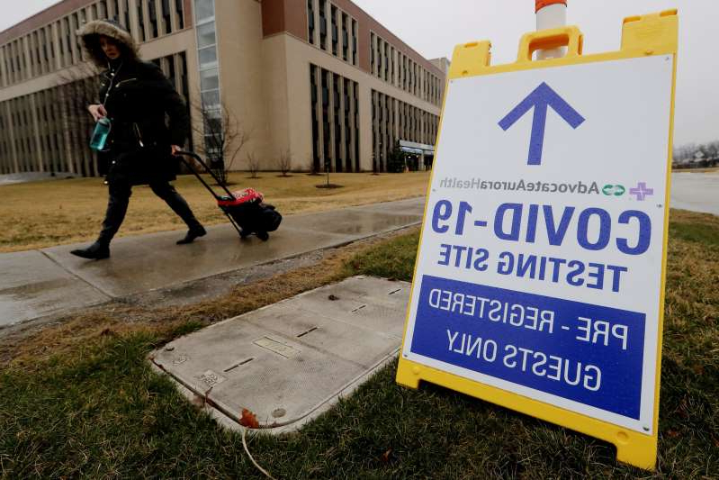A COVID-19 testing sign at Advocate Lutheran General Hospital in Park Ridge, Ill., Wednesday, March 18, 2020.