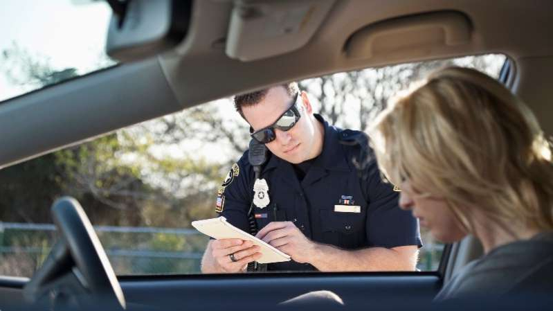 a man sitting in a car: DUI-101