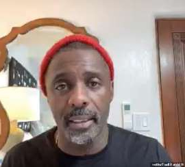 Idris Elba smiling for the camera: New video: Idris Elba has suggested that he may have caught coronavirus from Canadian Prime Minister Justin Trudeau 's wife Sophie, 44, after the two met shortly before they both tested positive for COVID-19