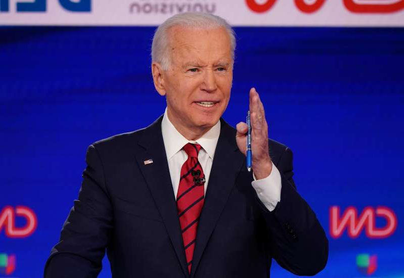 Joe Biden wearing a suit and tie: Former Vice President Joe Biden at the Democratic presidential debate in Washington, D.C., on March 15, 2020.