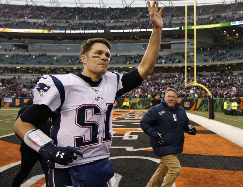 Tom Brady et al. sitting around a baseball field: FILE - In this Dec. 15, 2019, file photo, New England Patriots quarterback Tom Brady (12) waves to the crowd after an NFL football game against the Cincinnati Bengals in Cincinnati. Tom Brady is an NFL free agent for the first time in his career. The 42-year-old quarterback with six Super Bowl rings said Tuesday morning, March 17, 2020, that he is leaving the New England Patriots. (AP Photo/Frank Victores, File) ORG XMIT: NY150
