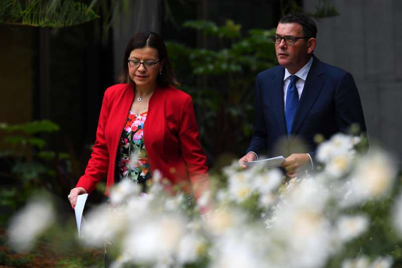 Daniel Andrews, Jenny Mikakos are posing for a picture: The Premier has announced extra funding for Victoria's health system in response to the virus crisis.