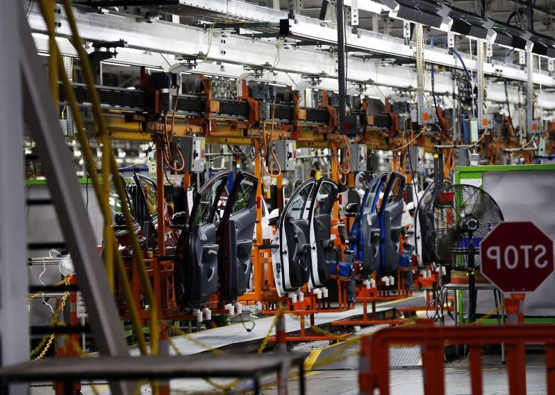 a close up of a metal rail: Vehicles move along the production line at the General Motors Co. Orion Assembly Plant in Orion Township, Michigan, U.S., on Tuesday, June 13, 2017. The largest U.S. automaker will expand its fleet of autonomous Chevrolet Bolts to 180 of the electric vehicles, Chief Executive Officer Mary Barra said Tuesday.