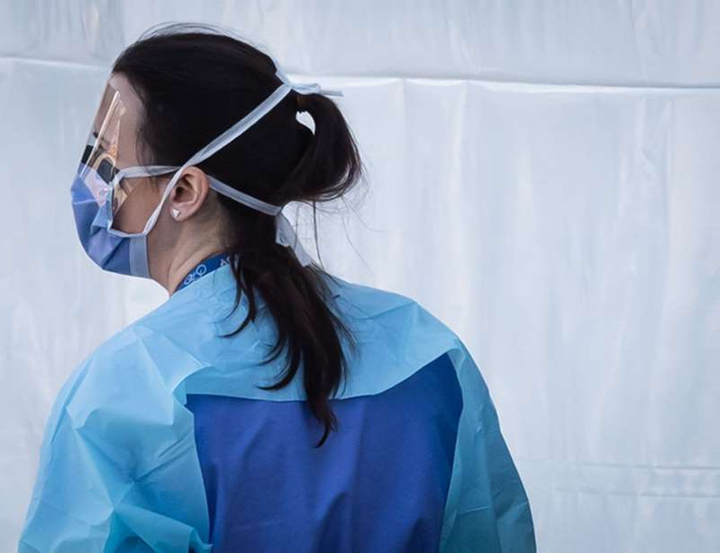 a woman wearing glasses: A hospital worker wearing a face shield and mask is seen at a COVID-19 assessment centre for staff at Lions Gate Hospital, in North Vancouver, on Thursday, March 19, 2020. THE CANADIAN PRESS/Darryl Dyck