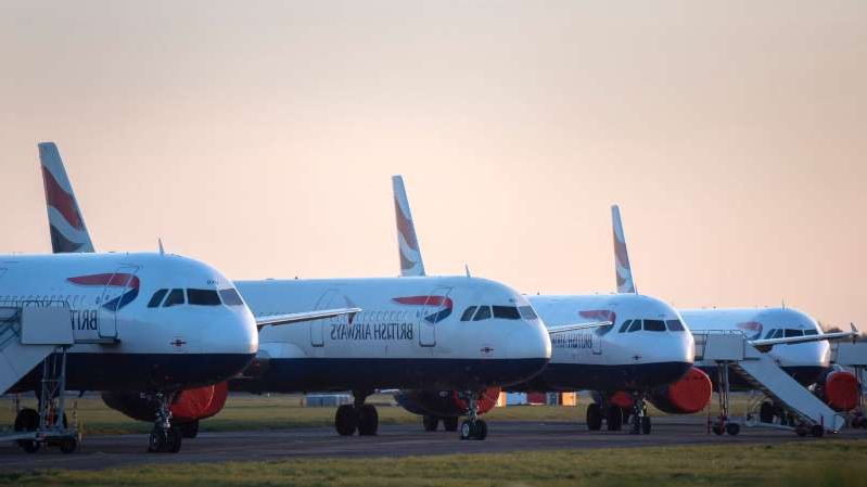 a large passenger jet sitting on top of a runway: Britons have been left stranded abroad due to the coronavirus outbreak