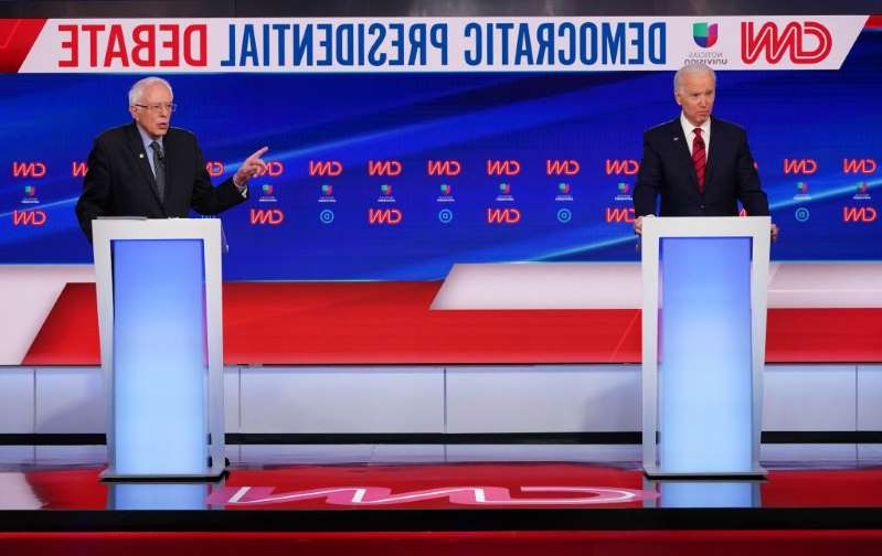 Joe Biden, Bernie Sanders are posing for a picture: Democratic presidential hopefuls former Vice President Joe Biden and Vermont Senator Bernie Sanders take part in the 11th Democratic Party 2020 presidential debate in a CNN Washington Bureau studio in Washington, D.C. on March 15.