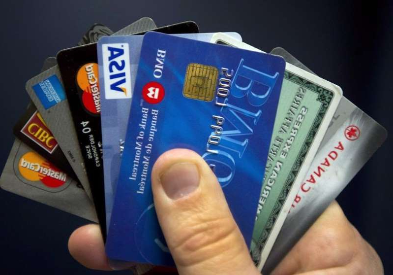 a hand holding a box: Credit cards are displayed in Montreal, Wednesday, December 12, 2012.