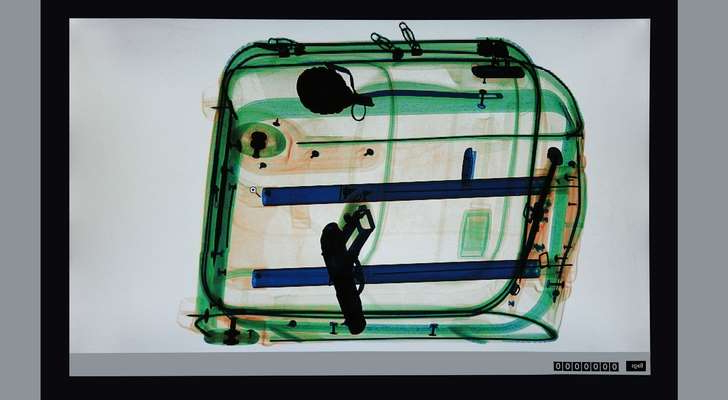 a close up of a monitor: X-ray of a suitcase at the airport