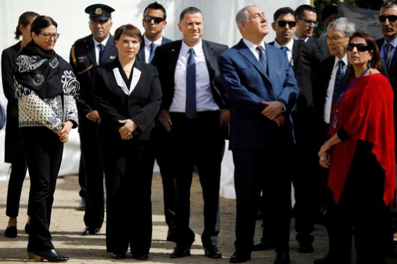 a group of people posing for the camera: FILE PHOTO: Israeli Prime Minister Benjamin Netanyahu and Israeli Knesset Speaker Yuli Edelstein attend a ceremony marking the annual Israeli Holocaust Remembrance Day at the Yad Vashem World Holocaust Remembrance Center in Jerusalem