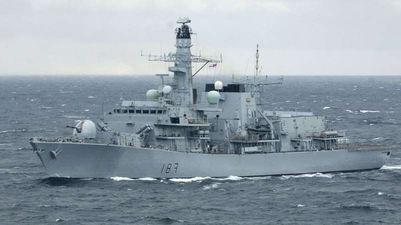 a large ship in a body of water: HMS Sutherland was involved in the Royal Navy operation