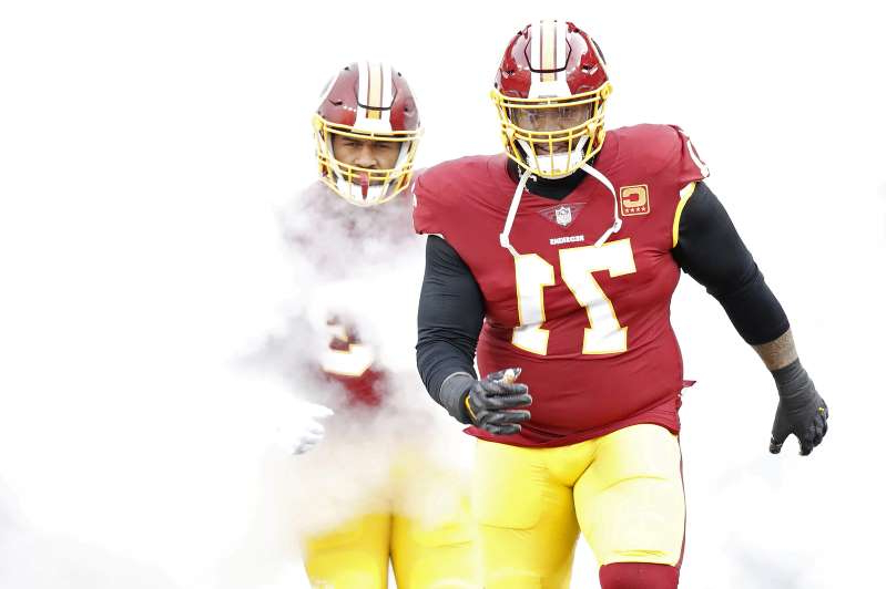 a person wearing a costume: Star offensive tackle Trent Williams (71) has been displeased with Washington for a while now.
