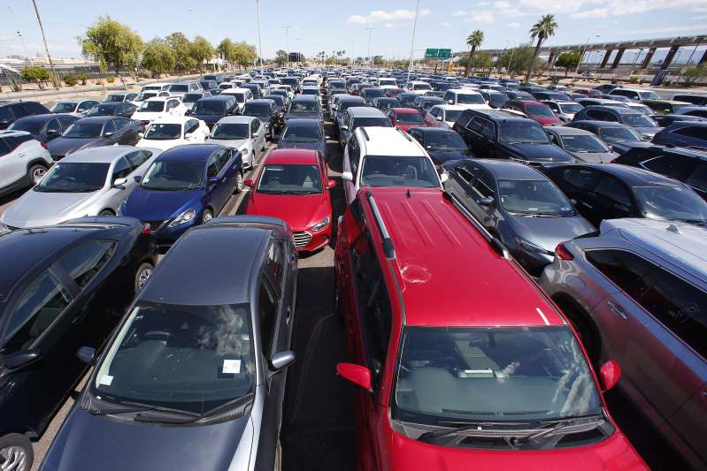 Cars are stored in the special events parking lot at Phoenix Sky Harbor International Airport on March 23, 2020.