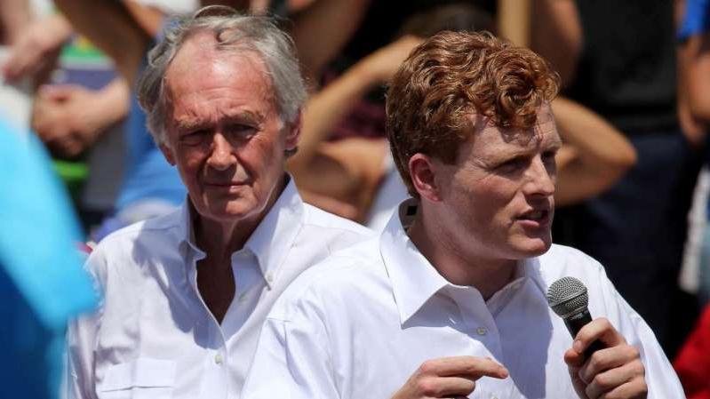 Ed Markey standing in front of a crowd: Congressman Joe Kennedy, left, and Sen. Edward Markey speak to demonstrators during the Together and Free Rally Against Family Separation at City Hall Plaza in Boston, June 30, 2018.