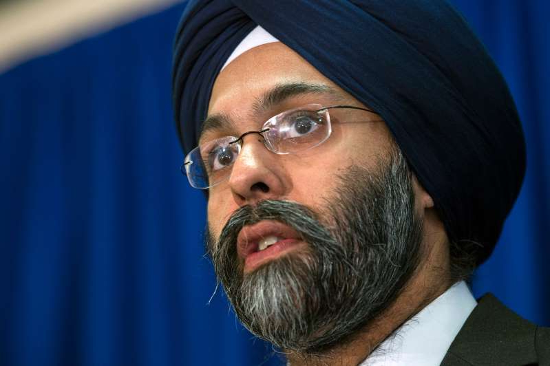 Gurbir Grewal wearing a blue hat: Attorney General Gurbir S. Grewal discusses arrests relating to 'Operation Stonewall' during a press conference Monday, March 18, 2019 at the Camden County Metro Police Department in Camden, N.J.
