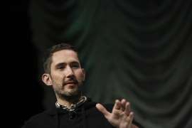 Kevin Systrom holding a camera