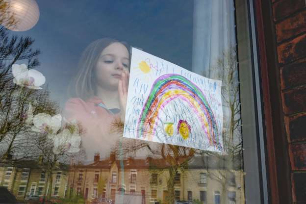 Slide 1 of 57: MANCHESTER, ENGLAND - MARCH 24: 5-year-old Charlie Rose places a drawing of a rainbow in her front window as schools remain closed on March 24, 2020 in Manchester, United Kingdom. British Prime Minister, Boris Johnson, announced strict lockdown measures urging people to stay at home and only leave the house for basic food shopping, exercise once a day and essential travel to and from work. The Coronavirus (COVID-19) pandemic has spread to at least 182 countries, claiming over 10,000 lives and infecting hundreds of thousands more. (Photo by Anthony Devlin/Getty Images)