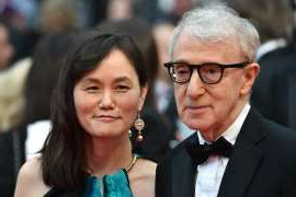 Woody Allen, Soon-Yi Previn are posing for a picture: US director Woody Allen and his wife Soon-Yi Previn pose as they arrive on May 11, 2016 for the screening of the film