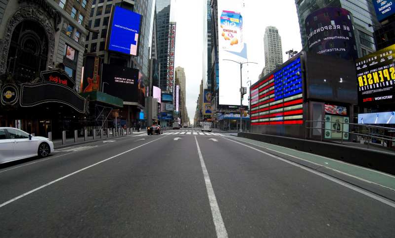 a city street: Seventh Ave near West 42nd Street is seen devoid of people and traffic during the Coronavirus pandemic outbreak. Gov. Andrew Cuomo said the rate of increase of coronavirus cases in New York has grown, and the rate of new infections is doubling every three days.