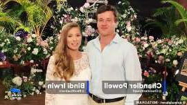 a person with collar shirt: 'It feels incredible that I get to call you my husband now!' They tied the knot on Wednesday in an intimate ceremony at Queensland's Australia Zoo. And now a sweet video from Bindi Irwin and Chandler Powell's wedding day has been shared with fans