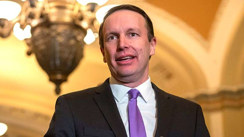 Chris Murphy wearing a suit and tie: Lawmakers, labor leaders ramp up calls to use Defense Production Act