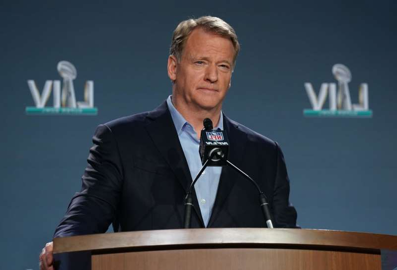 Roger Goodell wearing a suit and tie: Roger Goodell will not put up with criticism to not postpone the NFL draft.