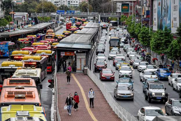 Slide 1 of 50: GUANGZHOU, CHINA - MARCH 26: Cars and buses are seen in Guangzhou, China on March 26, 2020. After two months of hard work, the new coronavirus was brought under control and cities in China began to resume operations. (Photo by
