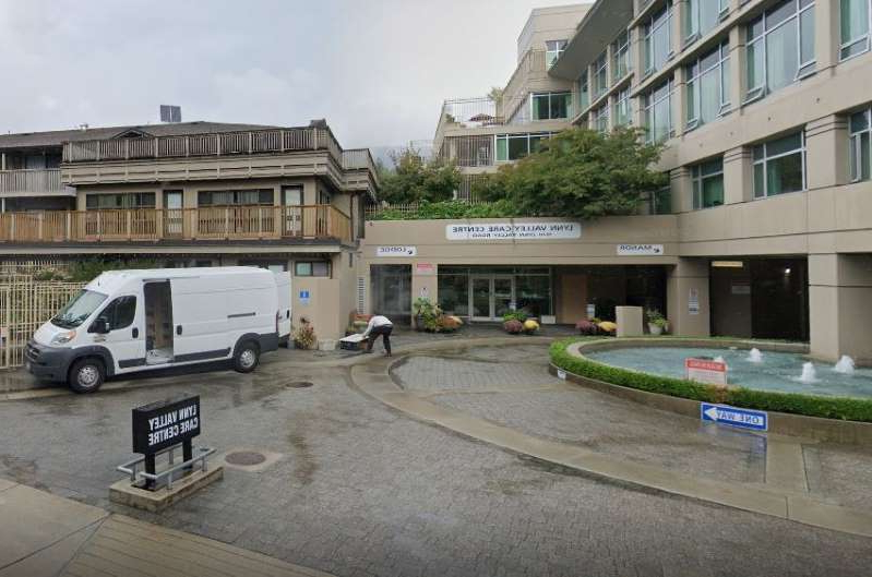 a car parked on the side of a building: The Lynn Valley Care Centre is participating in an international study on the effectiveness of anti-malaria drug hydroxychloroquine against COVID-19.