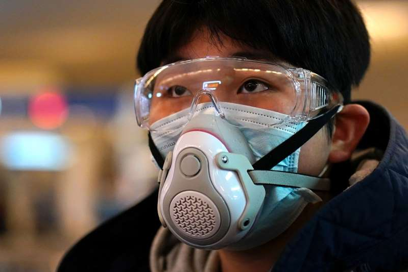 A passenger wearing a protective mask arrives at a railway station in Wuhan on the first day inbound train services resumed following the novel coronavirus disease (COVID-19) outbreak, in Wuhan of Hubei province, the epicentre of China's coronavirus outbreak, March 28, 2020. REUTERS/Aly Song