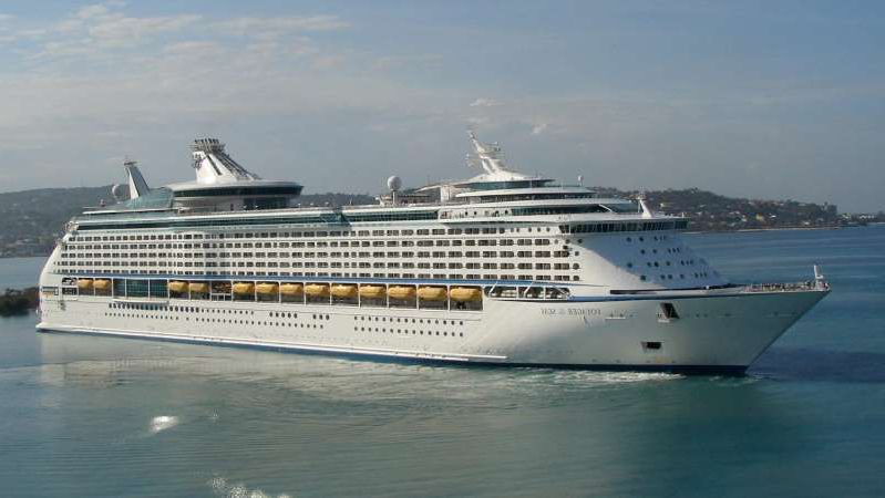 a large ship in the water: The Voyager of the Seas had a number of confirmed cases of coronavirus, including one passenger who died. (Source: Voyager of the Seas Facebook)