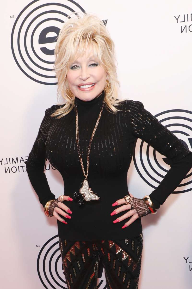 Dolly Parton wearing a costume posing for the camera: Dolly Parton attends the We Are Family Foundation Celebration Gala in New York City on Nov. 5, 2019.