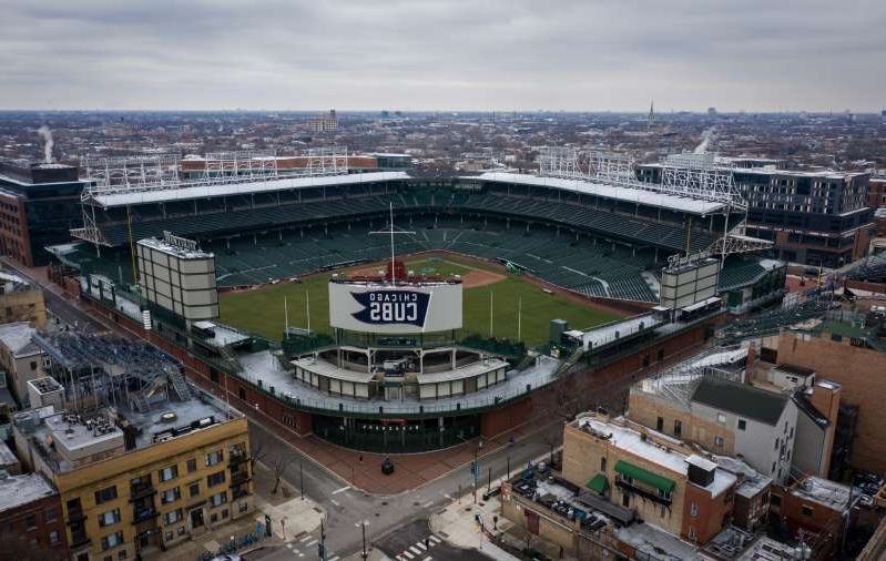 a view of a city: Aerial views of empty streets around Wrigley Field in Chicago on Monday, March 23, 2020.