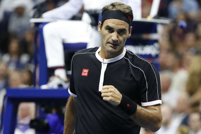 Roger Federer standing in front of a crowd: Sep 3, 2019; Flushing, NY, USA; Roger Federer of Switzerland reacts after winning a point against Grigor Dimitrov of Bulgaria (not pictured) in a quarterfinal match on day nine of the 2019 US Open tennis tournament at USTA Billie Jean King National Tennis Center.