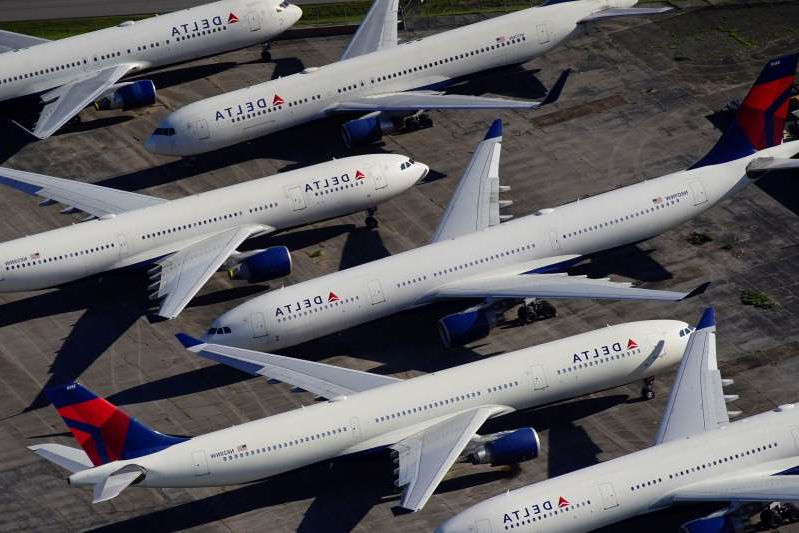 a plane sitting on top of a tarmac: FILE PHOTO: Delta Air Lines passenger planes parked in Birmingham