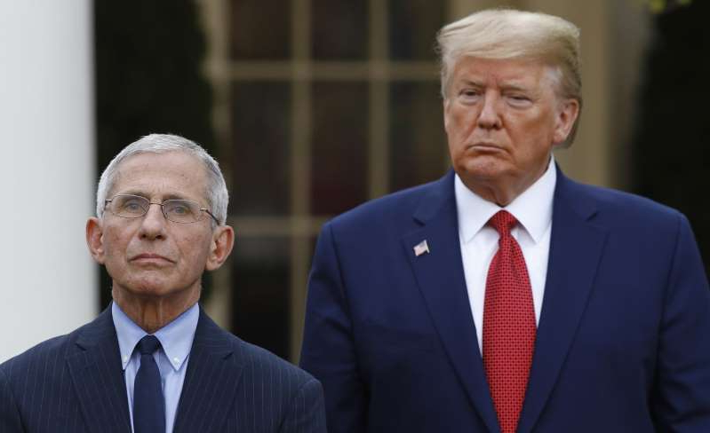 Donald Trump, Anthony S. Fauci are posing for a picture