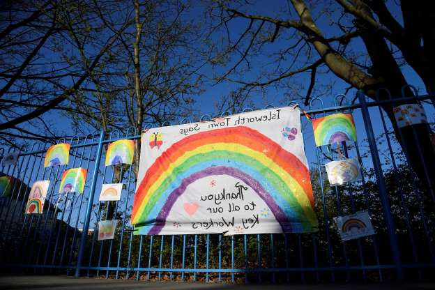 Slide 1 of 50: Rainbow messages of support and thanks are seen attached to school railings at Isleworth Town school, as the spread of the coronavirus disease (COVID-19) continues, London, Britain, April 1, 2020. REUTERS/Toby Melville