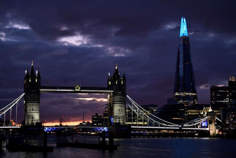 a large bridge lit up at night: The spread of the coronavirus disease (COVID-19) in London