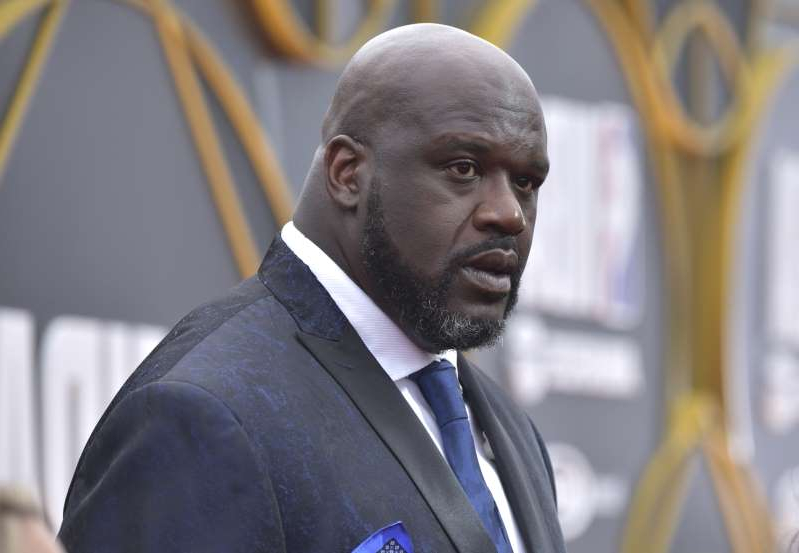 Shaquille O'Neal wearing a suit and tie: Shaquille O'Neal arrives at the NBA Awards on Monday, June 24, 2019, at the Barker Hangar in Santa Monica, Calif. (Photo by Richard Shotwell/Invision/AP)