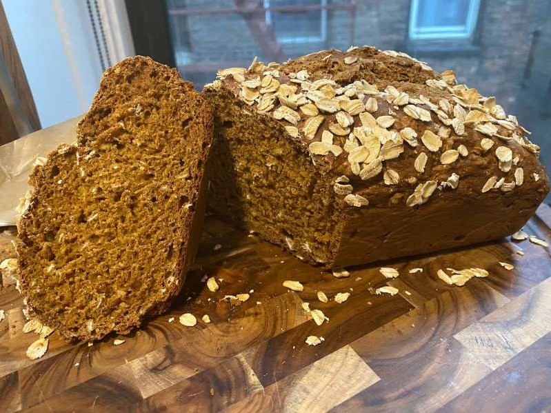 a piece of cake covered in chocolate: Get the recipe for Guinness Soda Bread