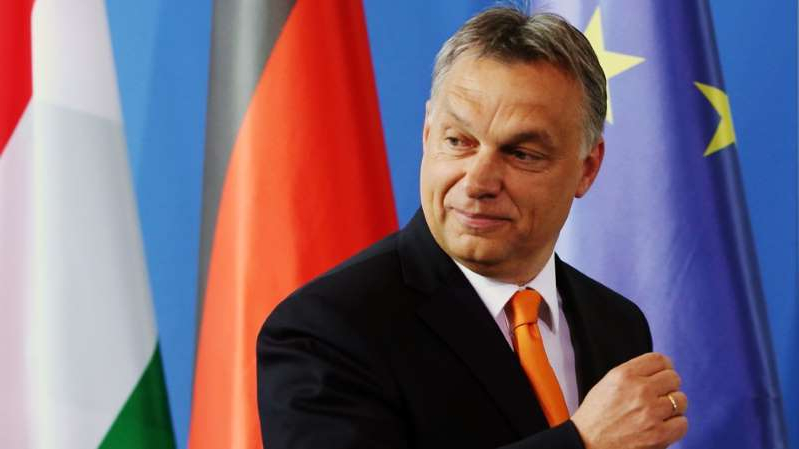 Viktor Orban wearing a suit and tie