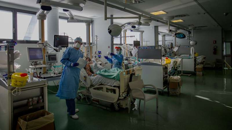 a person standing in a room: The intensive care unit for critical coronavirus patients at the Papa Giovanni hospital in Bergamo, near Milan in the Lombardy region of northern Italy.