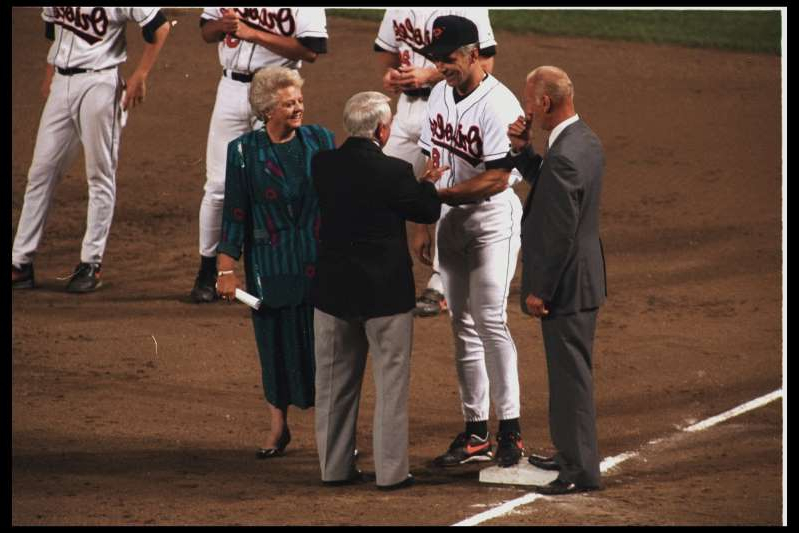 Baseball: Rear view of former Baltimore Orioles mgr. Earl Weaver, on field talking Cal Ripken Jr. #8, Ripken's father Cal Sr. & his mother during celebration after Ripken broke Hall of Famer Lou Gehrig's record for consecutive games played at 2131.  (Photo by Scott Wachter/The LIFE Images Collection/Getty Images)